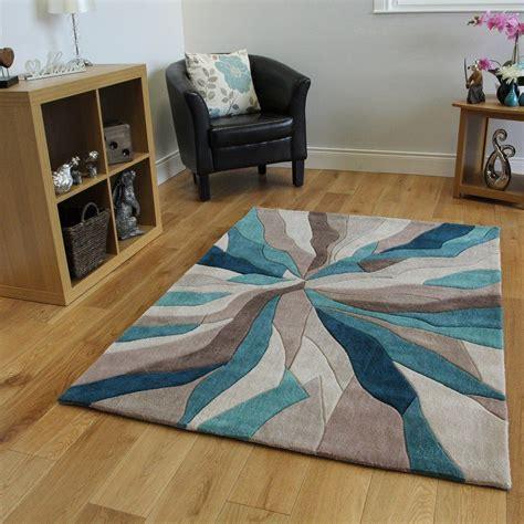 tapis contemporain bleu turquoise  taupe motif vagues  tailles avec images tapis