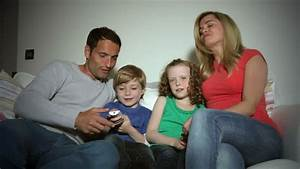 Group Of Teens Watching TV Together Stock Footage Video ...