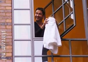 PHOTOS Gerard Butler spoofs Michael Jackson, dangles baby ...