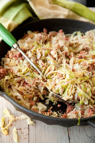 In a large serving bowl where you can stir the potatoes, crush the garlic clove and rub the inside of the bowl with it. Easy Corned Beef and Cabbage | Paula Deen
