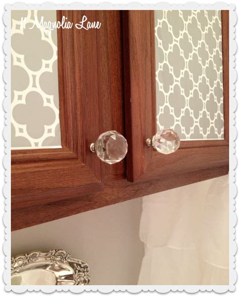 decorating kitchen cabinet doors use spray adhesive on wrapping paper to decorate cabinets 6487
