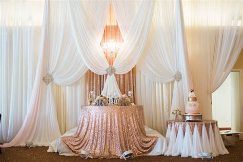 Sweetheart Table On Stage Next To The Cake Table Love