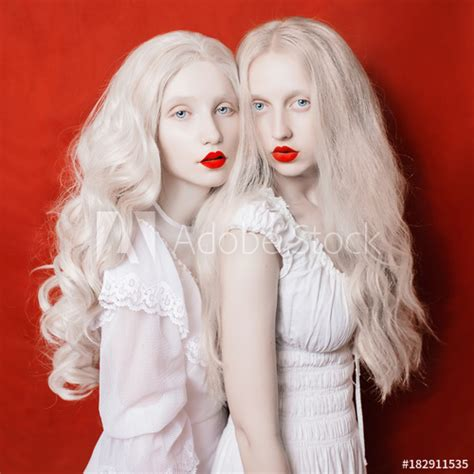Two Beautiful Blonde Girls With Long White Hair In White