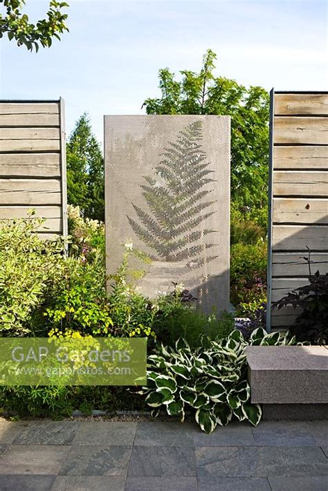 concrete wall garden gap gardens concrete wall and wooden fences in modern garden image no 0283905 photo by