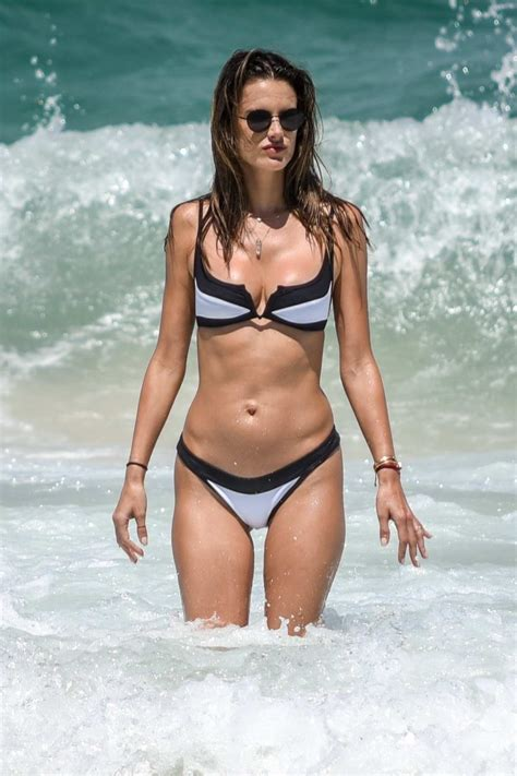 Alessandra Ambrosio wears a black and white bikini while ...
