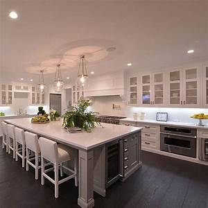 The 25 best large kitchen island ideas on pinterest for Kitchen colors with white cabinets with fat chef wall art