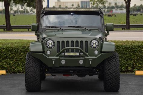 matte dark green jeep spotlight custom matte green jeep wrangler