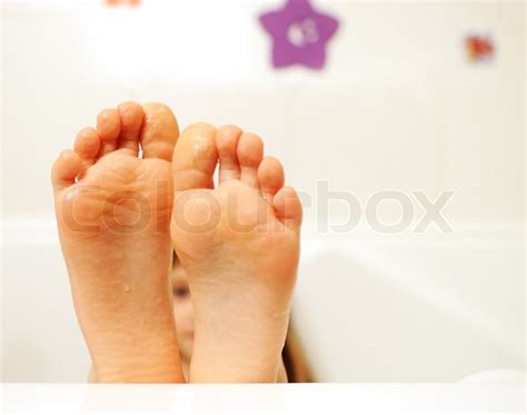 Feat In The Bathtub by Child Sticking Out Of The Bathtub Stock Photo