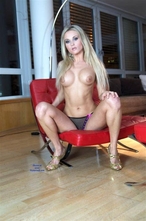 Topless Bloden In Red Chair May Voyeur Web Hall
