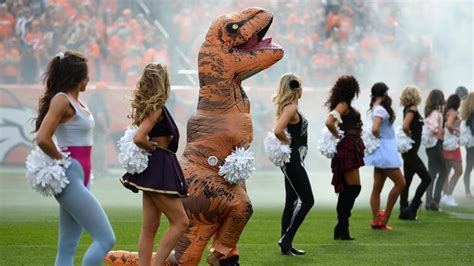 Broncos Cheerleader Dances In T-rex Costume During