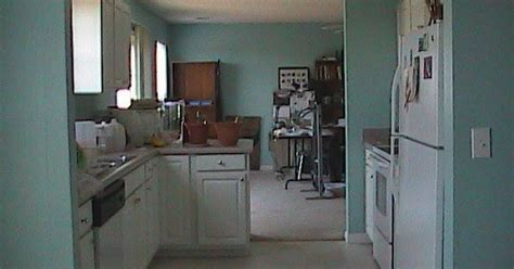 mobile home kitchen cabinets peeling repairing peeling vinyl on kitchen cabinets hometalk