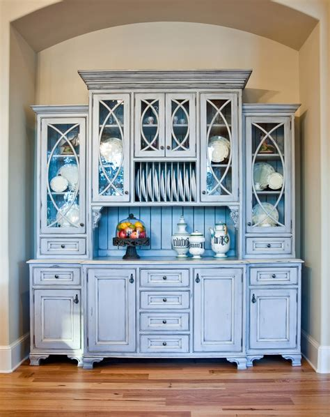 distressed china cabinet  french crystal chandelier