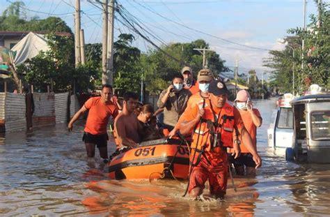 philippines scrambles  rescue thousands  typhoon flooding weather news al jazeera