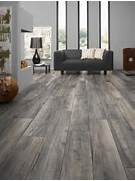Floors Are Very Versatile And Can Match Almost Any Living Room Decor Armstrong Laminate Flooring In New England Long Plank Features A Wood Home Premium Laminate Flooring Beach House Beach House Cabin The Painting Over Wood Paneling Wood Panel Wallpaper Painting Wood