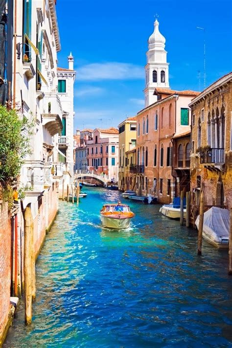 A Motor Boat In Beautiful Canal Venice Italy Stock