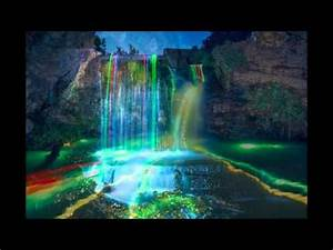Artists make neon waterfalls glow