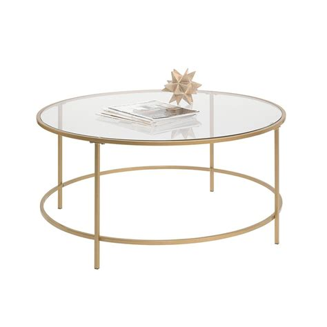 A tempered glass top and a gold metal frame give this table, which was crafted in india, a chic look. Gold Metal Coffee Table - Home Furniture Design