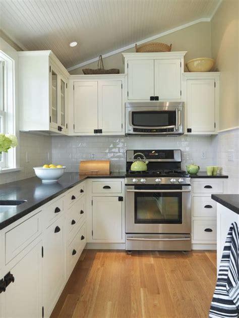 black countertop and white cabinets home design ideas