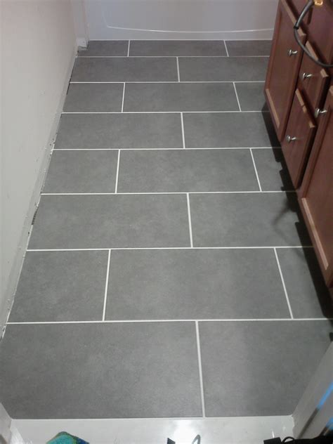 gray porcelain tile bathroom thinking about navy cabinets gray floors and more primitive and proper