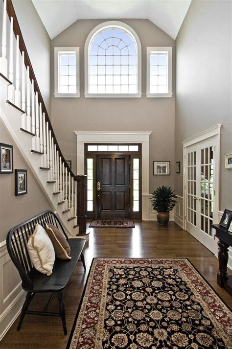 Grand Foyer large two story foyer doors white and wood