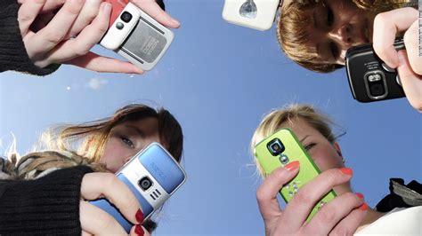 teen cell phone 50 of feel addicted to their phones poll says cnn