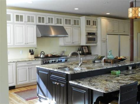 kitchen with cabinets staggered height island kitchens table 6505