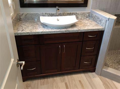 beautiful dark wood vanity  granite countertop