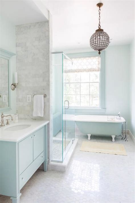 Turquoise blue bathroom features walls painted turquoise lined with a turquoise vanity topped
