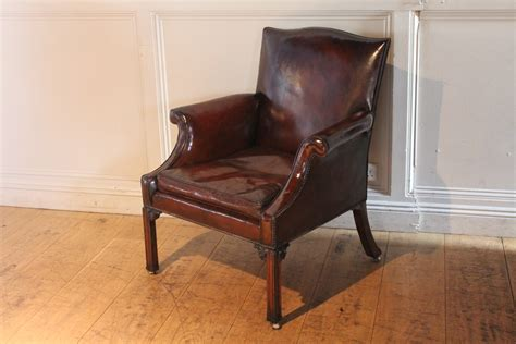 Sold/20c Brown Leather Armchair