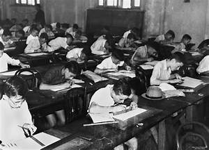School children doing exams inside a classroom   Title ...