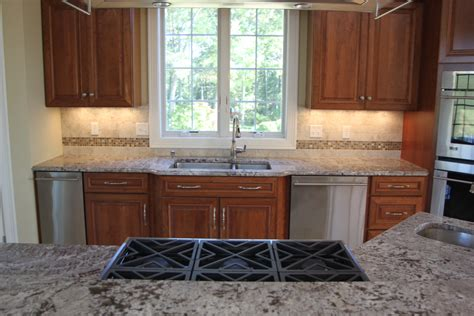 If i had the misfortune of living with this design i would put rubber door pads or door stops to protect the that way you could affix the overhanging remainder to the cabinet body, and no matter how aggressively. Matching Countertops to Cabinets | Dalene Flooring