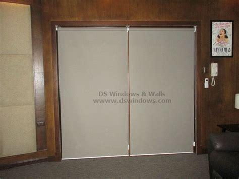 blackout roller shades mounted inside wooden sliding glass