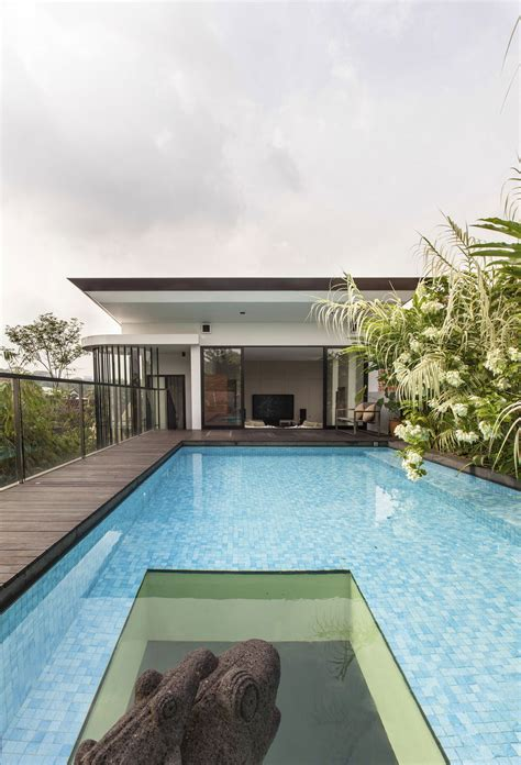 Lush Gardens And Peekaboo Roof Pool Define Contemporary Home