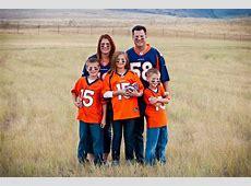Family wearing football jerseys Mountain View Photo