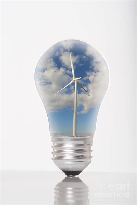 green energy wind turbine generator inside a light bulb
