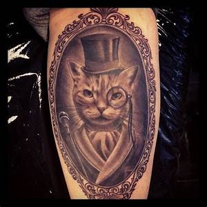 Grey Ink Cat With Black Hat Tattoo – Tattoosworldsite