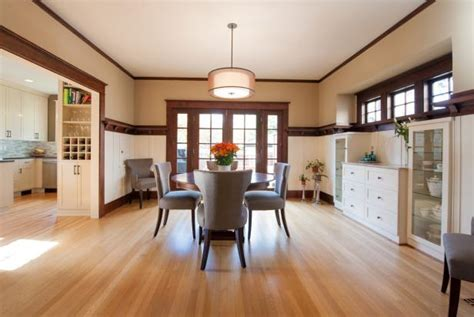 transitional dining room features oak flooring white cabinetry hgtv