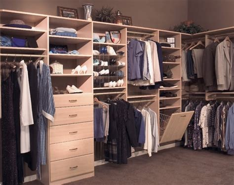 a custom closet with a built in drawer stack and her