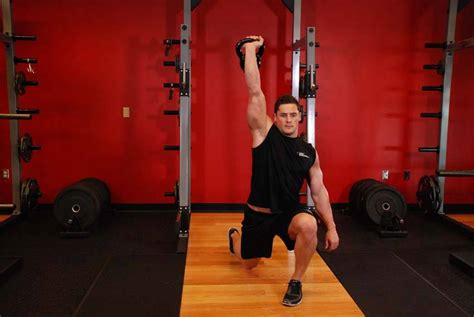 arm jerk kettlebell split exercise enlarge