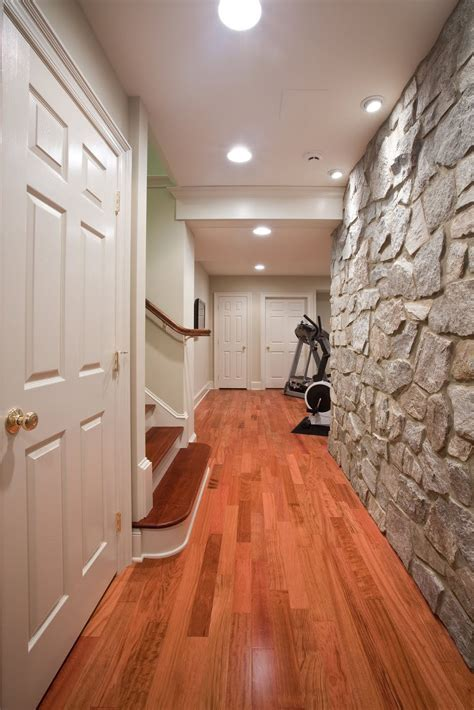 Basement Renovation With Rustic Stone Walls   iDesignArch