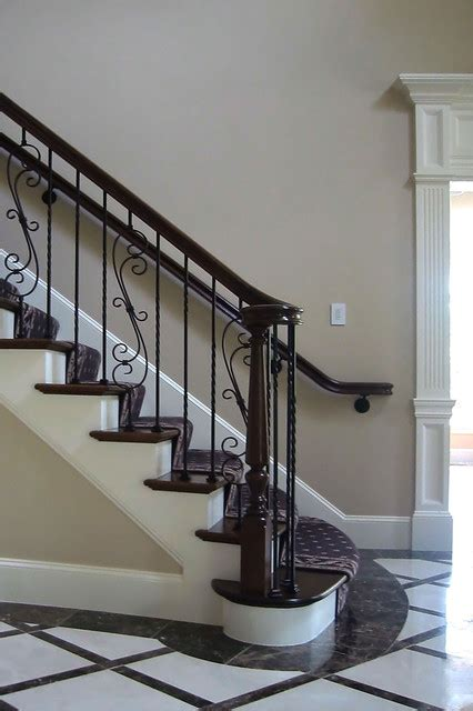 wrought iron balusters staircase traditional with area rug