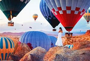 Fantasy-like images capture hot air balloons floating ...