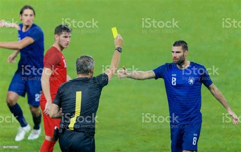 See more ideas about card stock, it is finished, yellow. Referee Holds Up Yellow Card Stock Photo - Download Image Now - iStock
