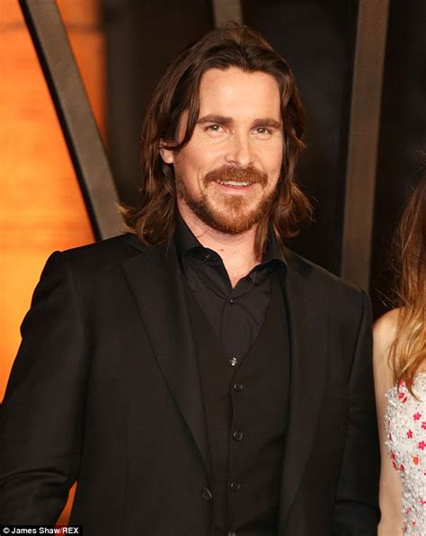 Christian Bale Displays His Dishevelled Hair Arrives