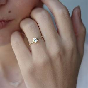 Tiny engagement ring trend youll love trends4uscom for Tiny wedding ring