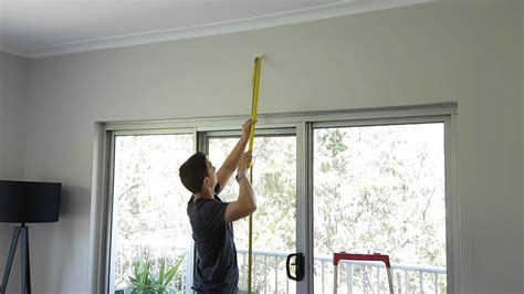 How To Install Drapery Rod by How To Install Curtain Rods Tracks