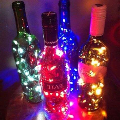 old wine bottles with christmas lights inside she s
