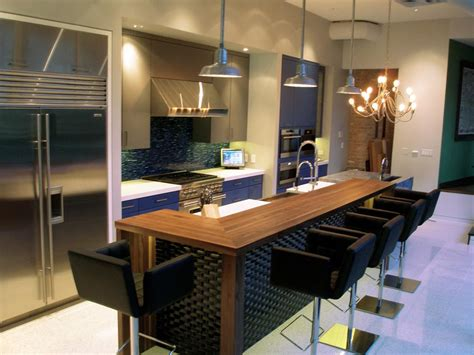 kitchen island with raised bar walnut wood countertop in chicago illinois by grothouse