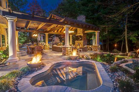 stone patio  outdoor kitchen hot tub  koi pond