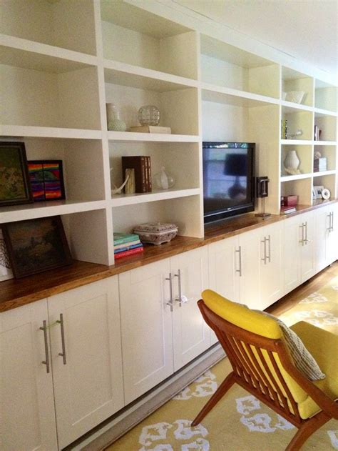 ikea built in cabinets built ins ikea adel cabinets below custom shelving on